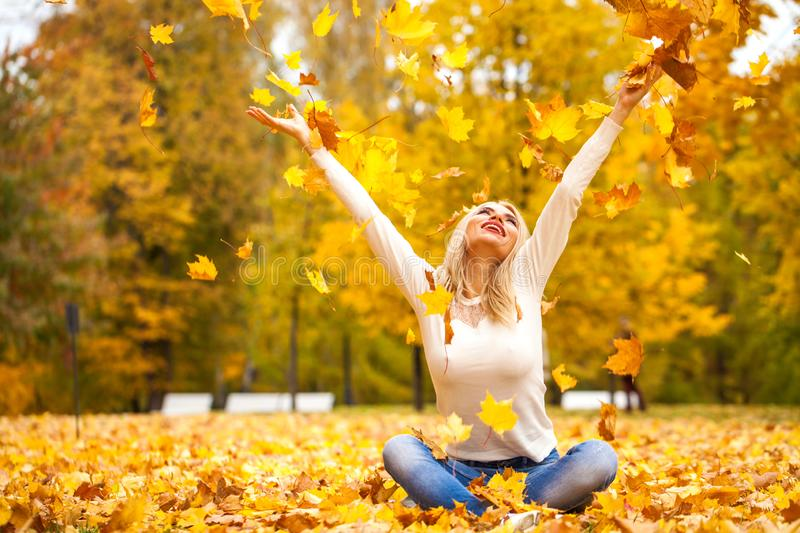 portrait of young blonde beautiful woman in autumn park royalty free stock images