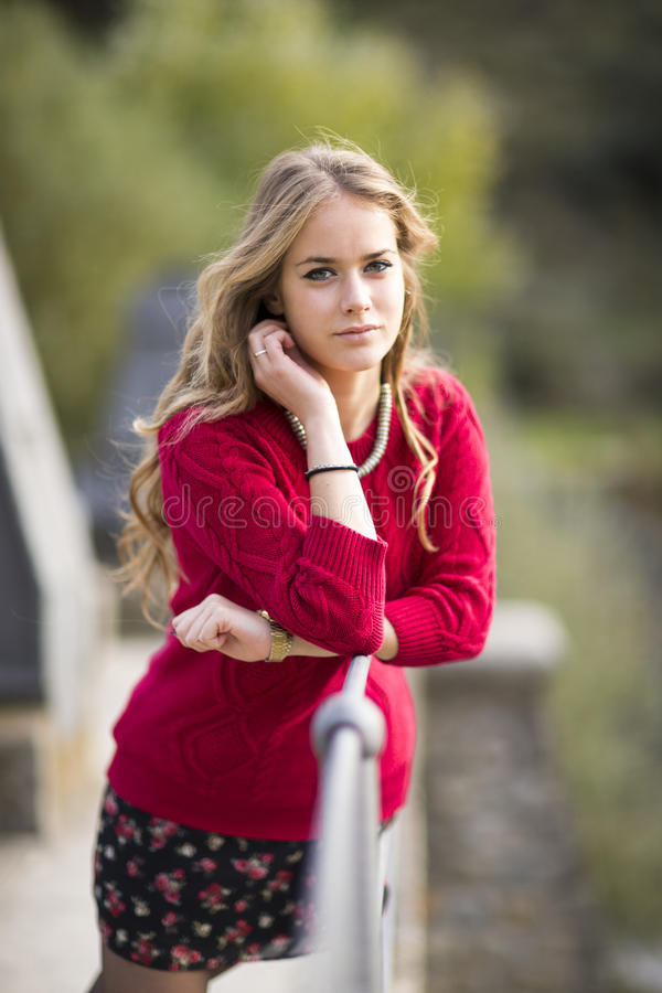 Portrait of a young blonde female on dam in natural space. stock photography