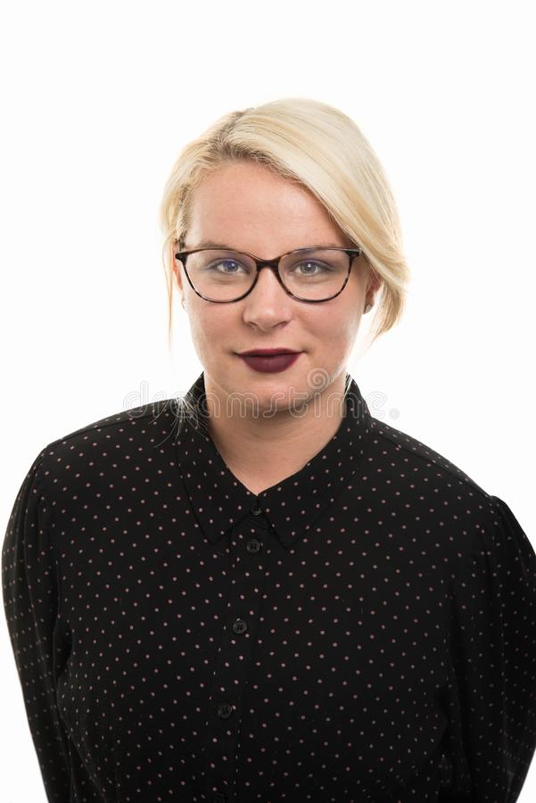 Portrait of young blonde female teacher wearing glasses royalty free stock photography