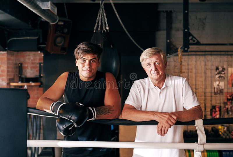 Portrait of a young boxer with his mature trainer royalty free stock photos