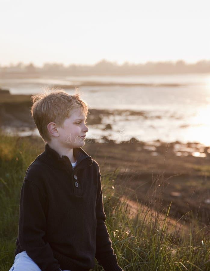 Portrait of young boy backlit sun stock photo