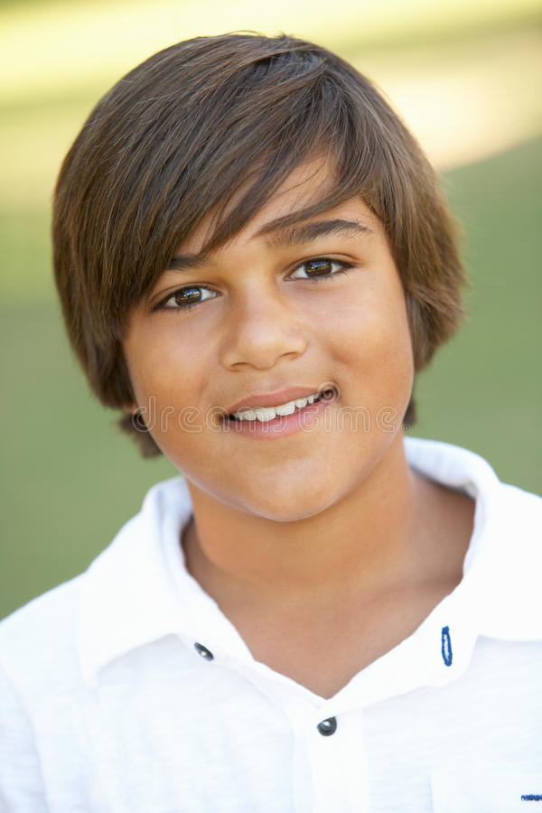 Portrait Of Young Boy In Park stock photo