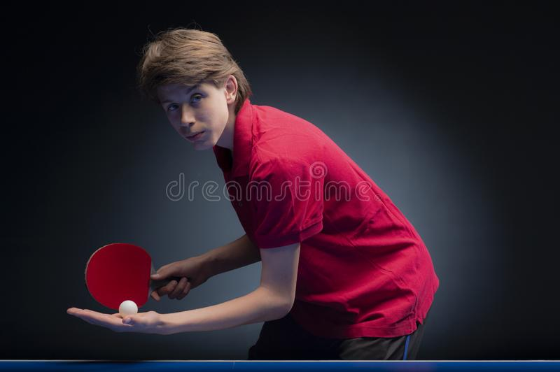 Portrait of young boy playing tennis stock photos