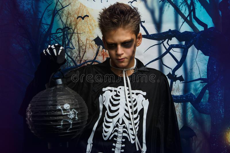 Portrait of young boy in skeleton costume with makeup. Celebration of holiday Halloween, the boy in the image, the skeleton theme. The vampire,bat royalty free stock photos