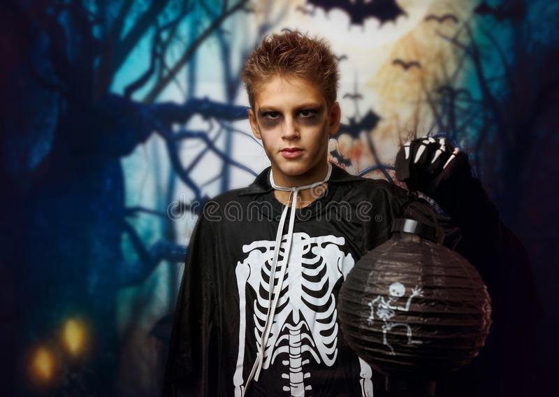 Portrait of young boy in skeleton costume with makeup. Celebration of holiday Halloween, the boy in the image, the skeleton theme. The vampire,bat stock photo