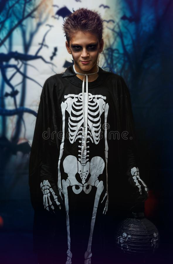 Portrait of young boy in skeleton costume with makeup. Celebration of holiday Halloween, the boy in the image, the skeleton theme. The vampire,bat royalty free stock photography