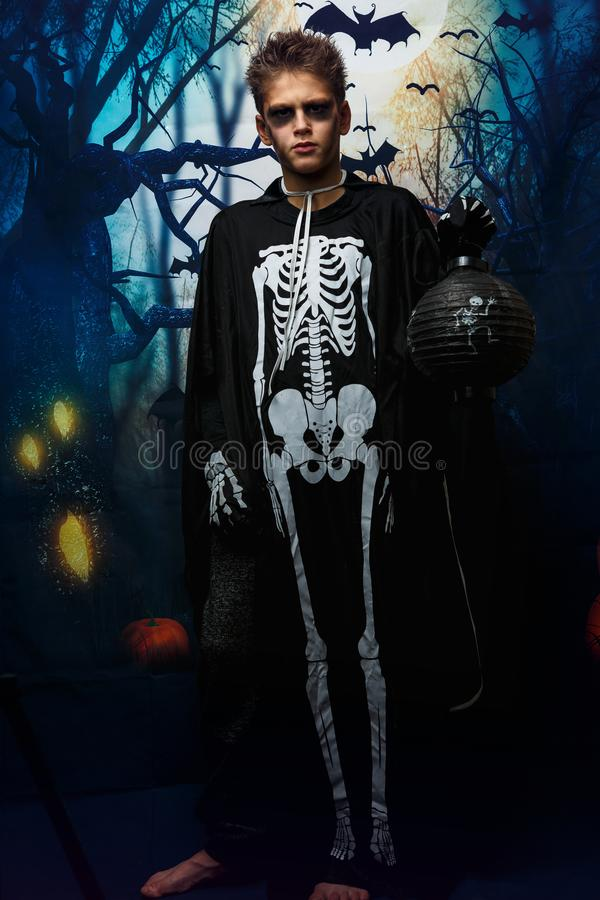 Portrait of young boy in skeleton costume with makeup. Celebration of holiday Halloween, the boy in the image, the skeleton theme. The vampire,bat stock photos