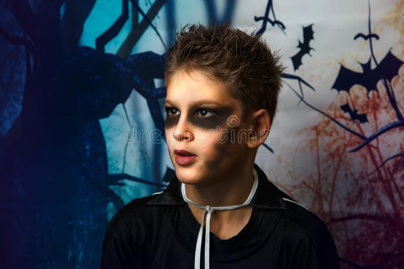 Portrait of young boy in skeleton costume with makeup. Celebration of holiday Halloween, the boy in the image, the skeleton theme. The vampire,bat stock images