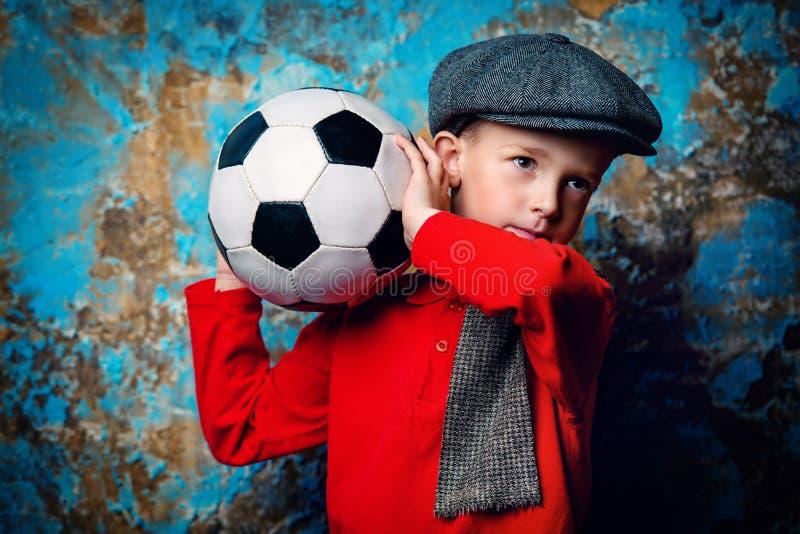 Holding soccer ball stock photo