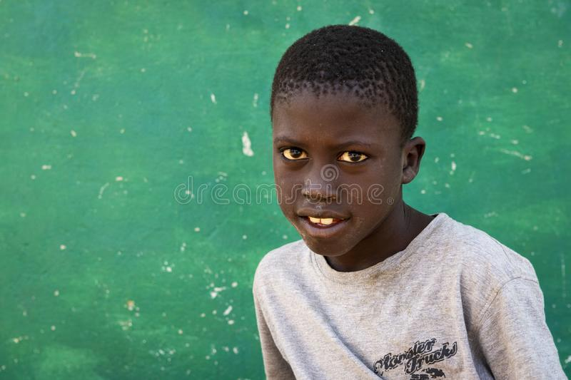 Portrait of a young boy at the village of Eticoga in the island of Orango. royalty free stock photography