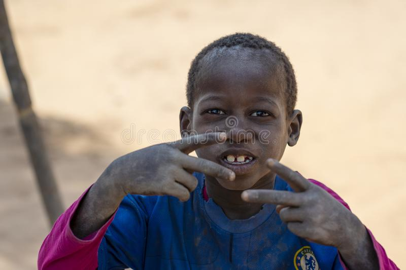 Portrait of of a young boy, in the village of Mandina Mandinga in the Gabu Region, Guinea Bissau. Gabu Region, Republic of Guinea-Bissau - February 7, 2018 stock images