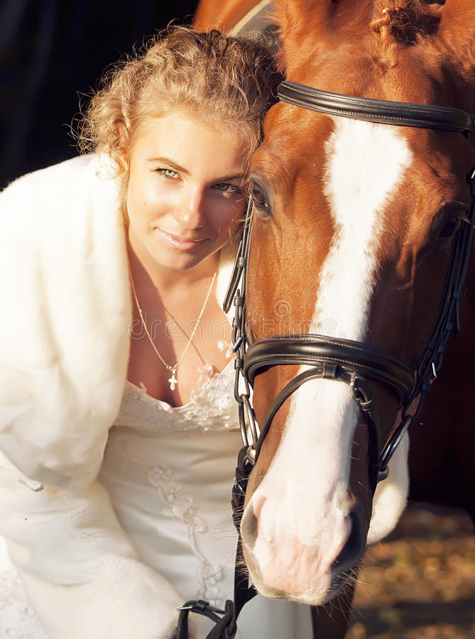 Portrait of young bride ride with horse royalty free stock photos