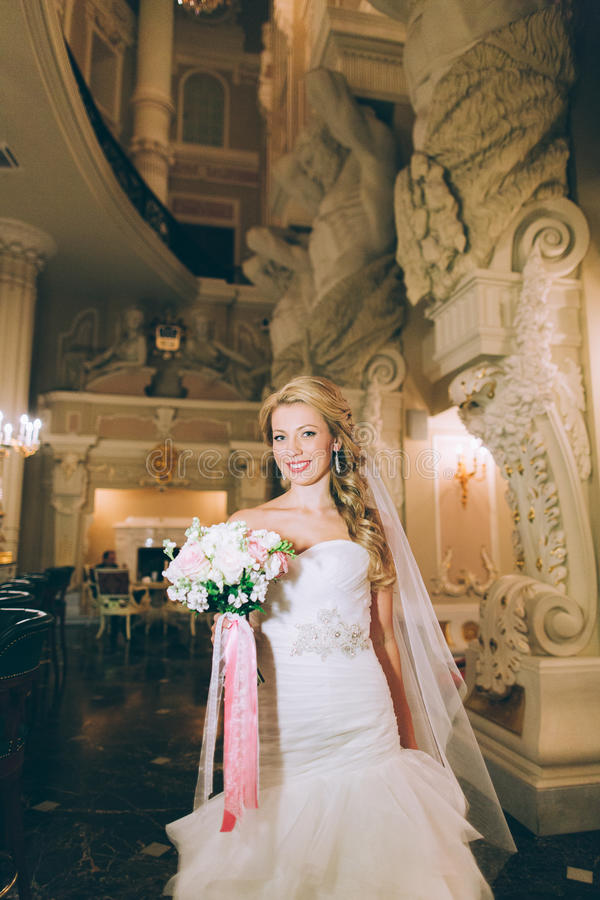 Portrait of a young bride about the white columns royalty free stock image