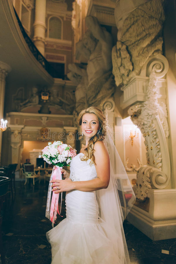Portrait of a young bride about the white columns stock image