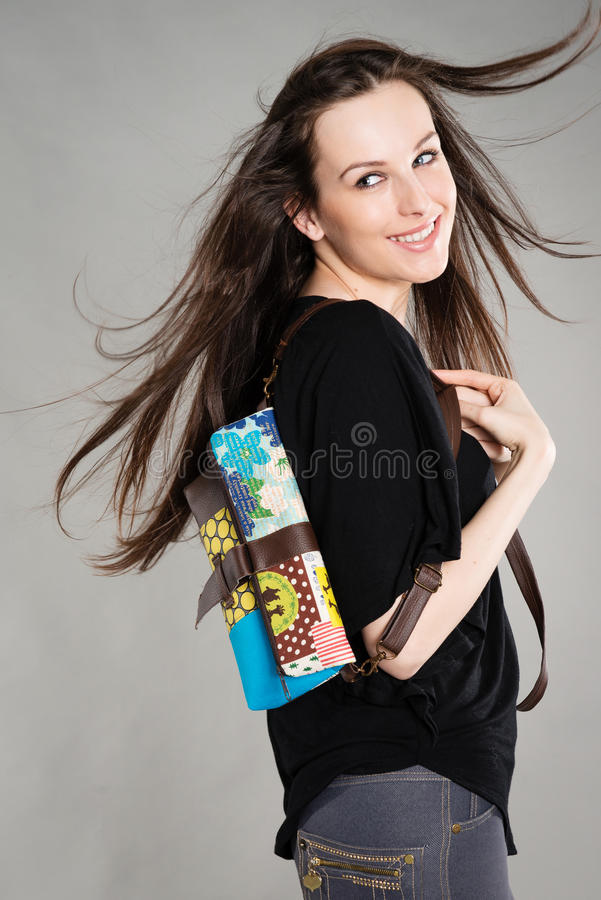 Download Attractive Brunette With A Bag Stock Photo - Image: 30037730