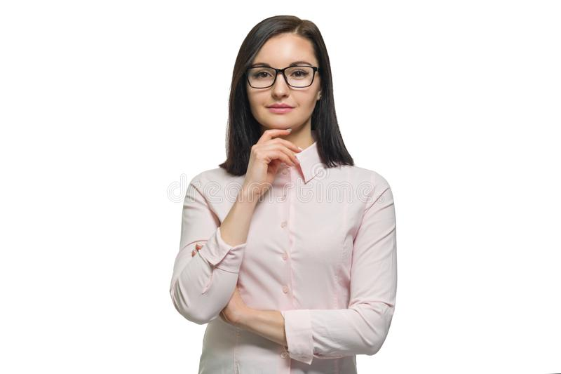 Portrait of young brunette business woman with glasses pink shirt close up on white isolated background royalty free stock image
