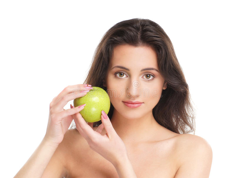 Download Portrait Of A Young Brunette Holdig An Apple Royalty Free Stock Image - Image: 20701946