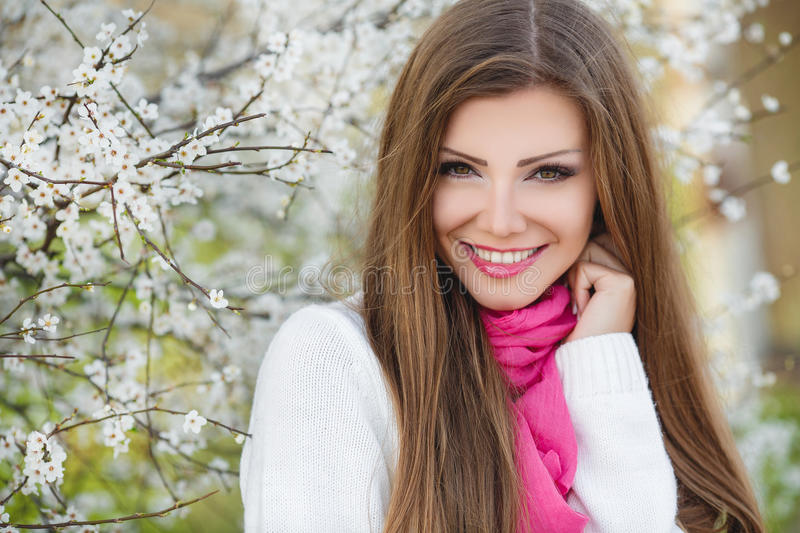Download Portrait Of A Young Brunette In A Lush Garden Stock Photo - Image: 38783964