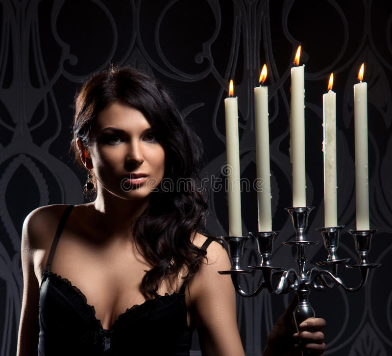 Portrait of a young brunette woman holding candles stock photos