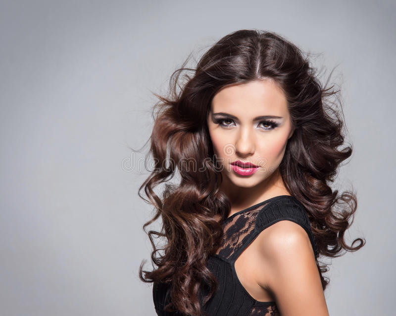 Portrait of a young brunette woman in makeup stock image
