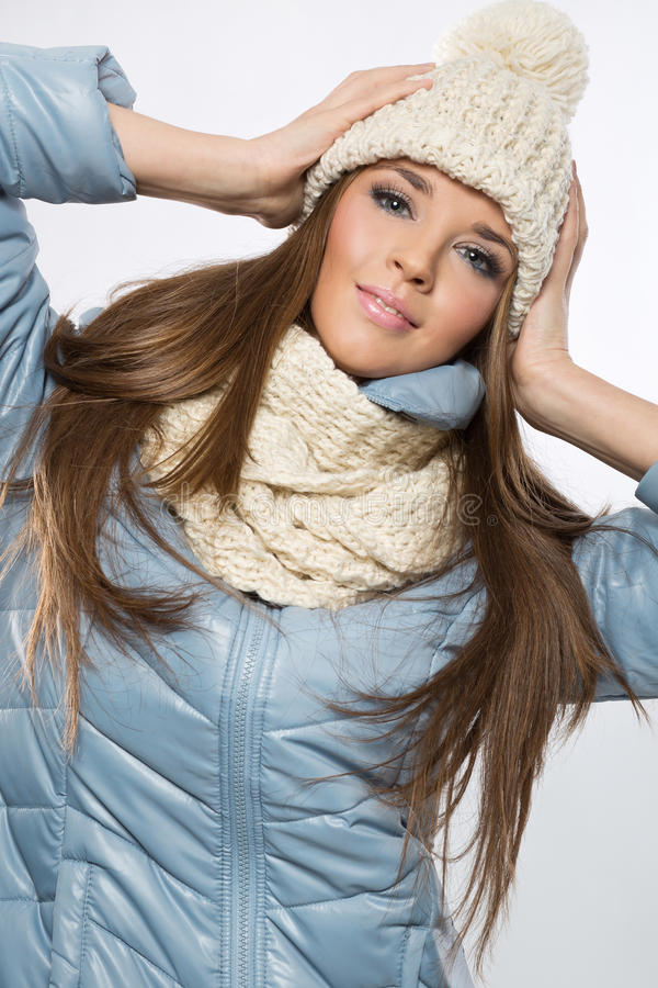 Portrait of a young brunette woman wearing a wool beige cap and stock photo