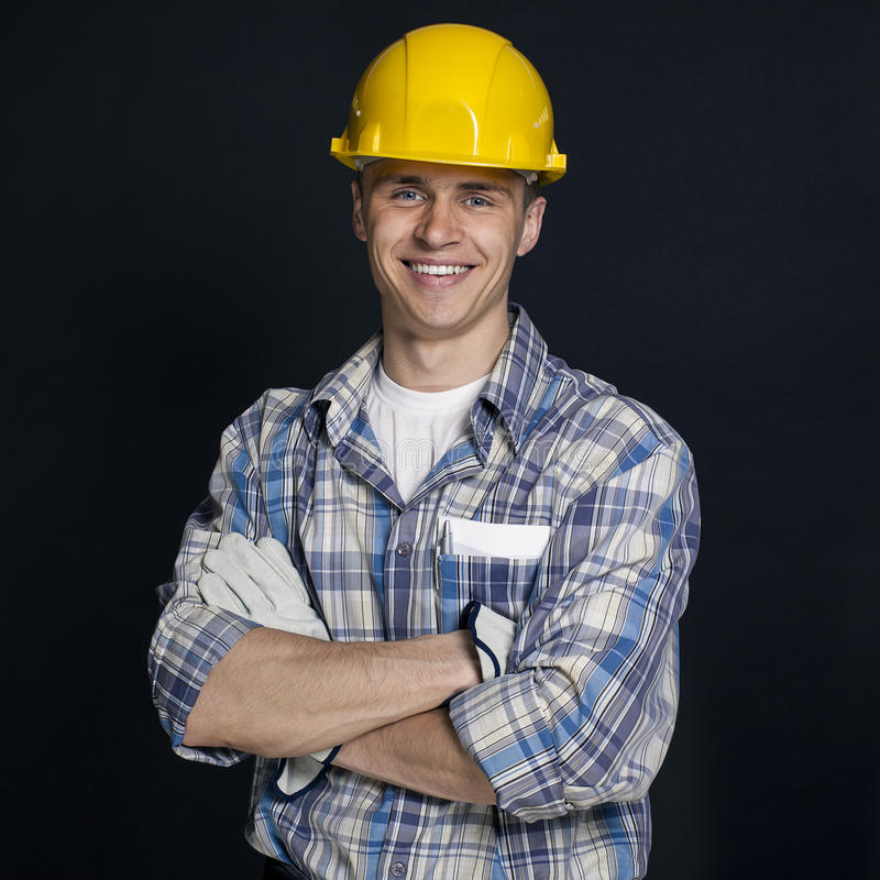 Portrait of a young builder stock photos