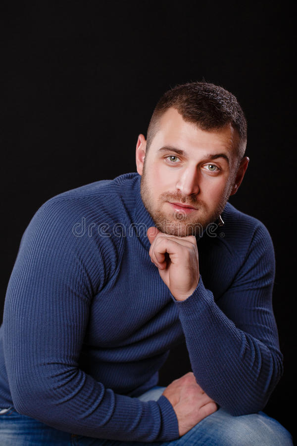 Portrait of a young business man in the blue shirt stock photos