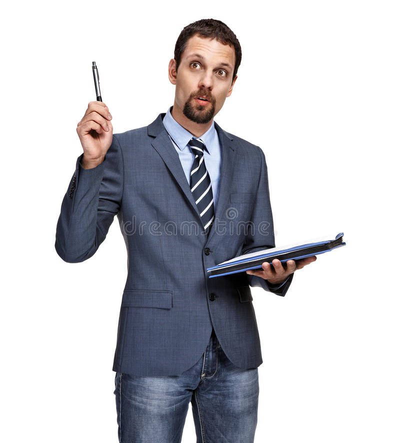 Portrait of a young business man have an idea while writing note stock photos