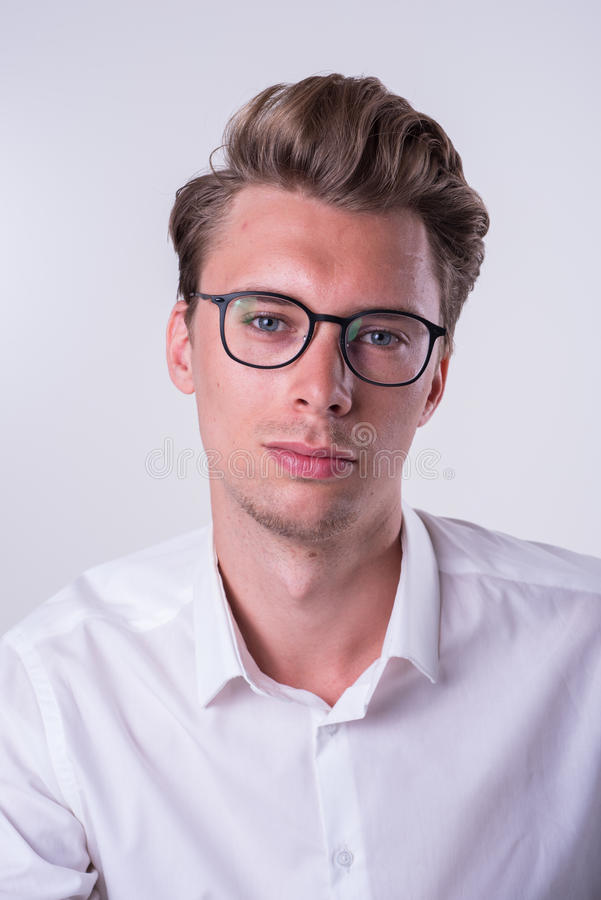 Portrait of a young business man in white shirt royalty free stock photos