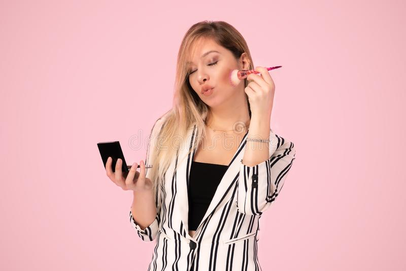 Portrait of Young Business Woman Doing Makeup stock photo