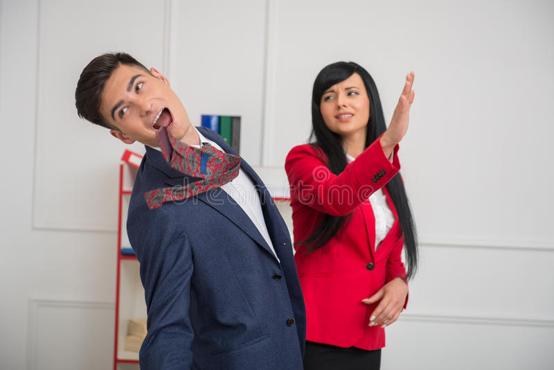 Portrait of young business woman giving a slap royalty free stock images