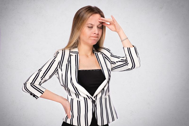 Portrait of a Young Business Woman Having Headache royalty free stock photo