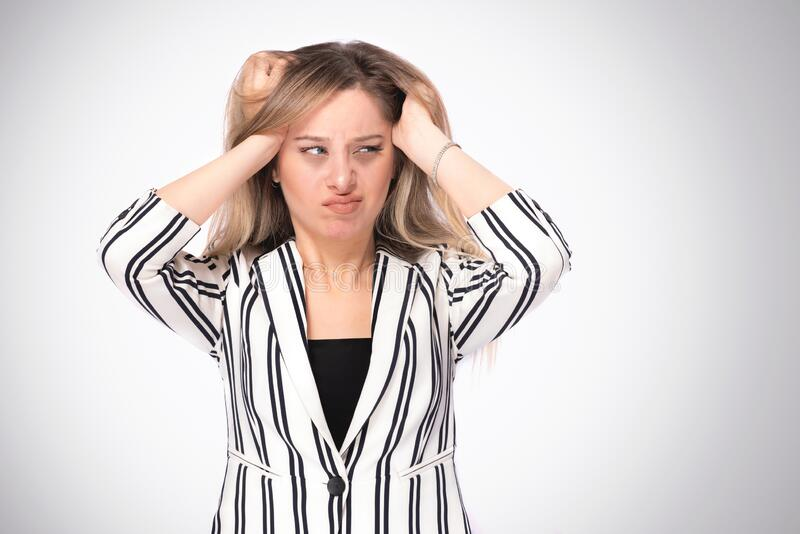 Portrait of a Young Business Woman Having Headache royalty free stock image