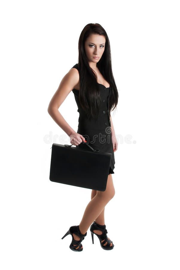 Portrait of a young business woman holding a case royalty free stock images
