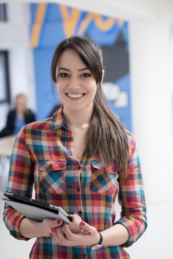 portrait of young business woman at office with team in background royalty free stock photos