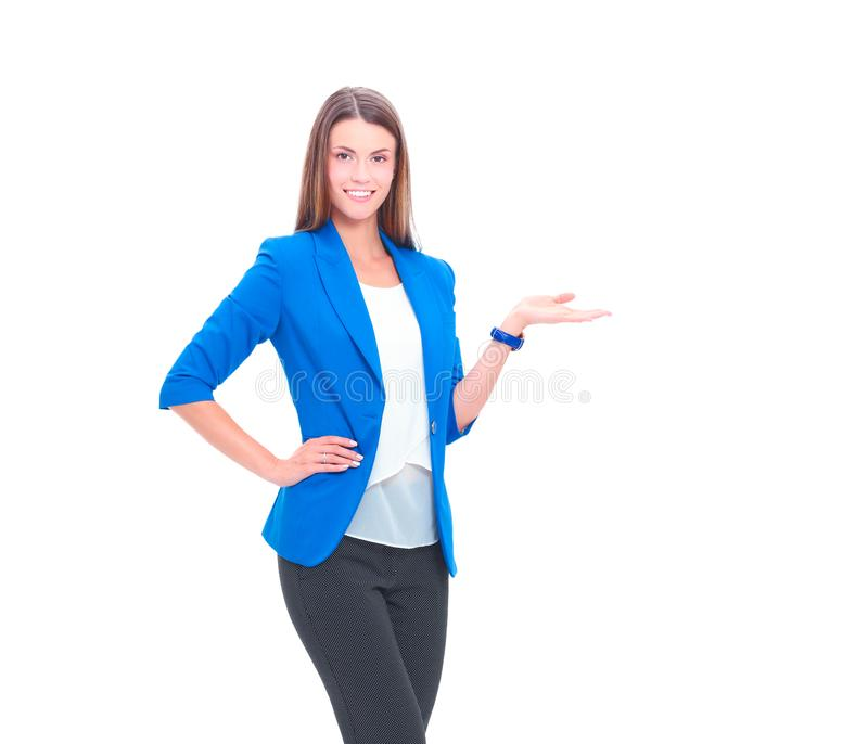 Portrait of young business woman pointing on white background stock photos