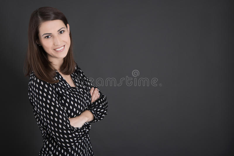 Portrait of young business woman standing before blackb stock photos