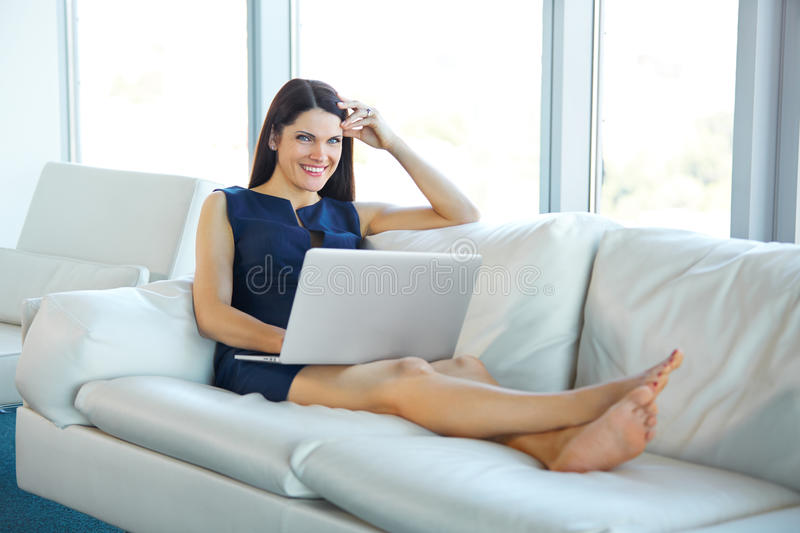 Portrait of a Young Business Woman Using Laptop Computer at Offi stock images