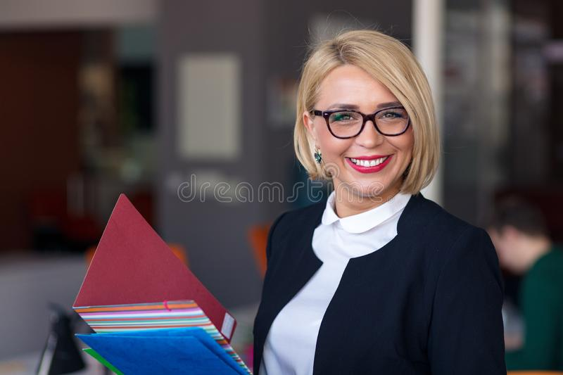 Portrait of a young business woman using laptop at office royalty free stock photo