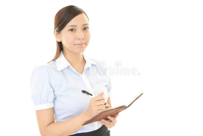 Portrait of a young business woman. The woman who enjoys working stock image