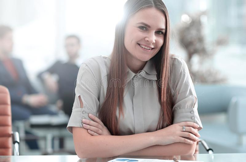 Portrait of young business woman at the workplace stock photo