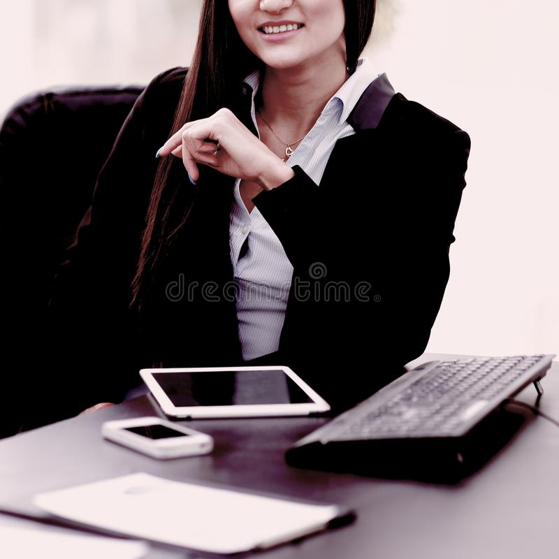 Portrait of young business woman at the workplace stock image