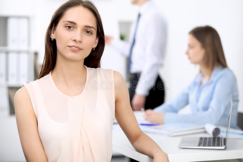 Portrait of a young business woman at meeting. Negotiation concept stock images