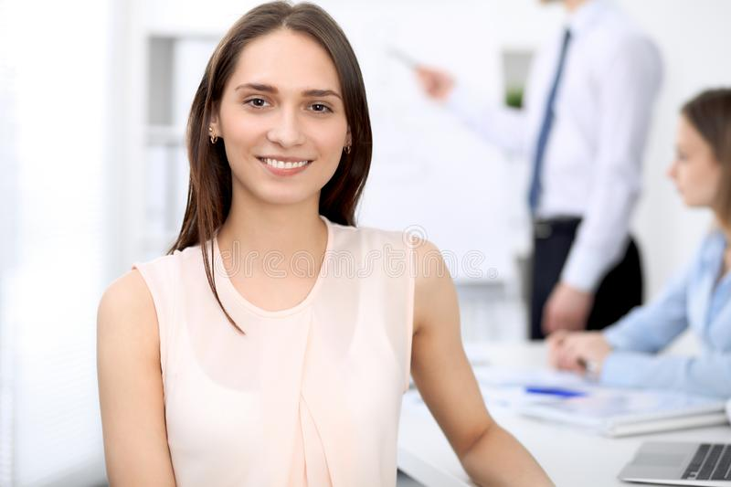 Portrait of a young business woman at meeting. Negotiation concept royalty free stock image