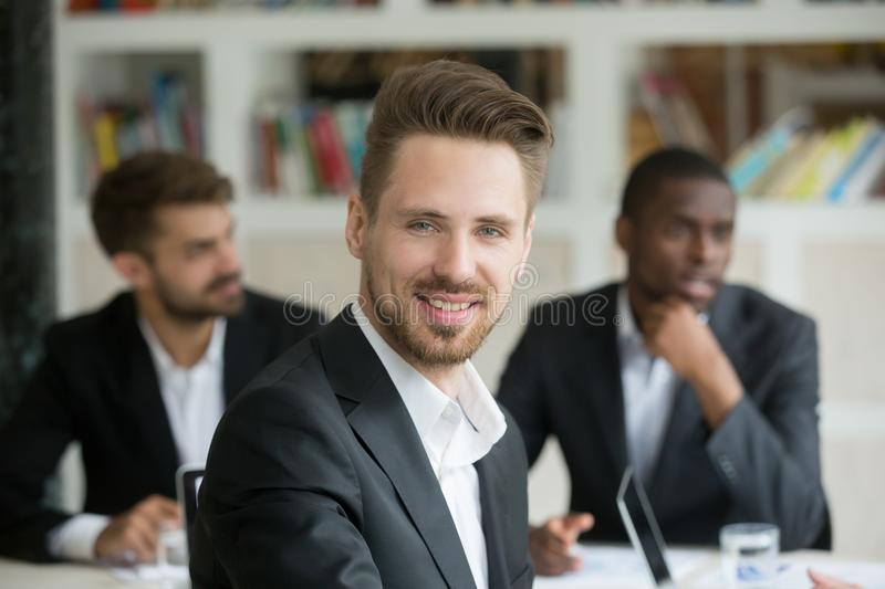 Caucasian businessman smiling looking to camera stock photo