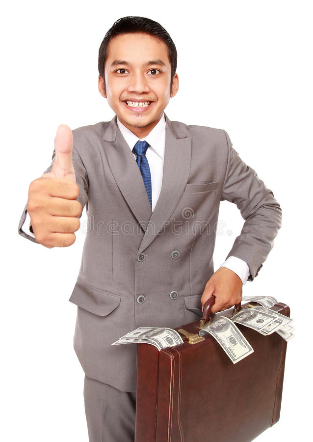 Portrait of a young businessman carrying a bag full of money stock image