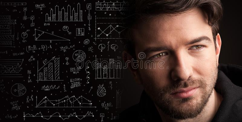 Portrait of a young businessman on dark background stock image