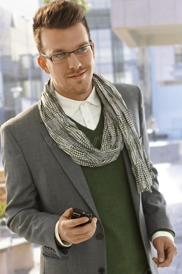 Portrait of young businessman in city stock images
