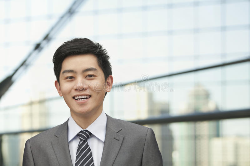 Portrait of young businessman with cityscape in background, Beijing, China royalty free stock photo