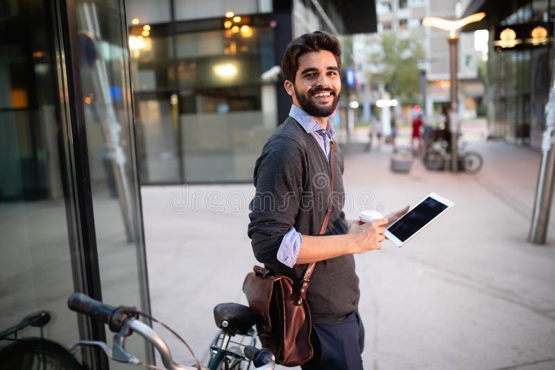 Portrait of young businessman holding tablet outdoor stock image
